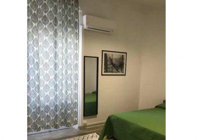 Aleni-House-Appartamento-arredamento-camera-matrimoniale