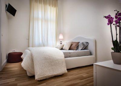 BB22 suites and bakery affittacamere camera da letto finemente arredata